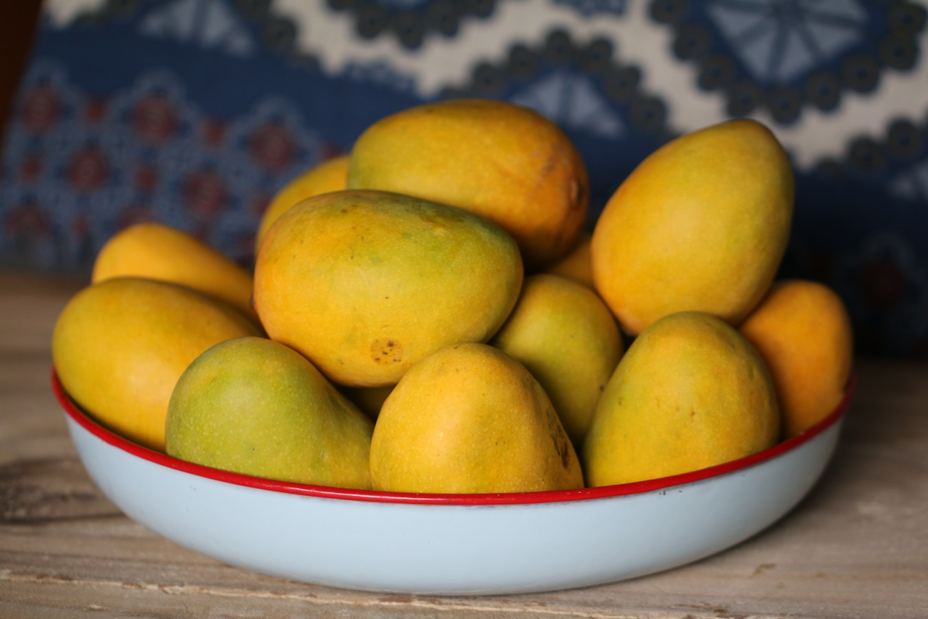 bowl of mangoes on table