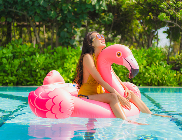 young-woman-on-flamingo-pool-floatie-600x462