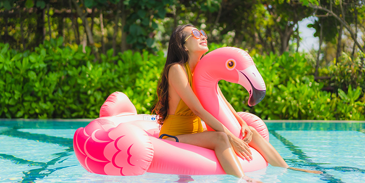young-woman-on-flamingo-pool-floatie-746x375