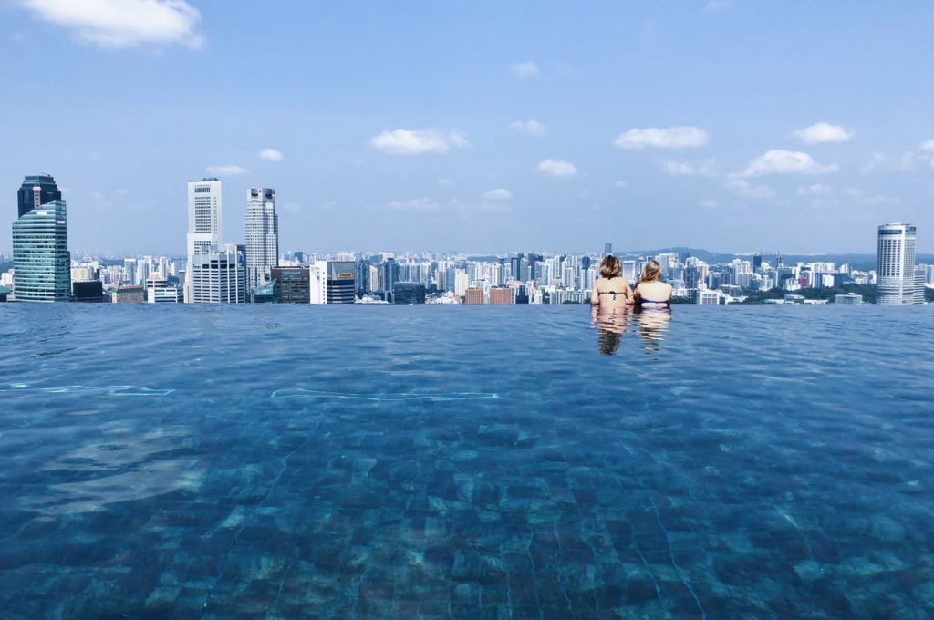 two-women-in-the-pool-on-top-of-marina-bay-sands-hotel-singapore